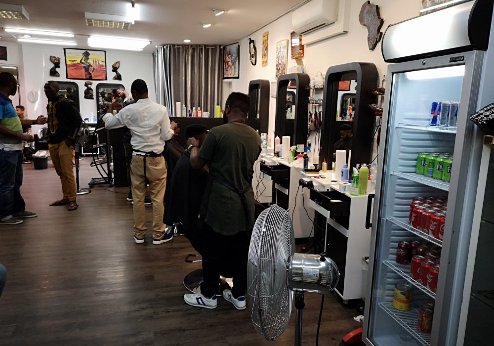 clickafric Malam African Barbershop crew at work